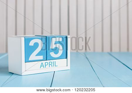 April 25th. International Day Of DNA. Image of april 25 wooden color calendar on white background.