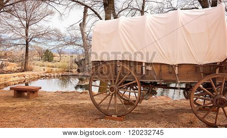 Covered Wagon Sits Next To Natural Spring Water