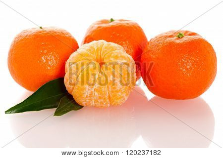 Fresh Unpeeled Orange Mandarin Citrus With Green Leafs And Half Of Peeled Slices Fruit Isolated Over