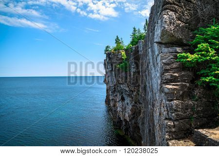 View of big long rocky cliff standing in Cyprus lake against blue bright sky at beautiful gorgeous B
