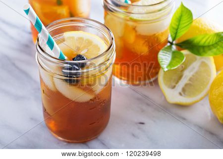 Ice tea with lemon and blueberry