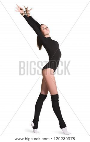 fitness, sport, people and healthcare concept - young sporty woman doing acrobatic exercise