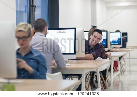 startup business, software developer working on desktop  computer at modern office