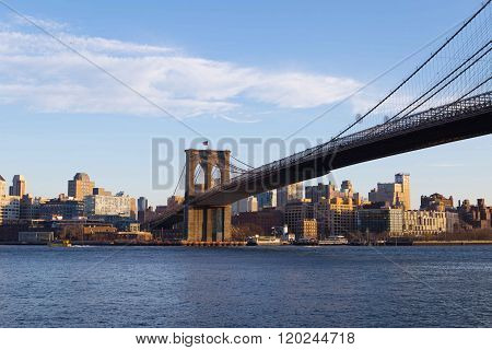 Brooklyn Bridge and downtown Brooklyn skyline just before sunset. Photographed in NYC in Feb 2016.