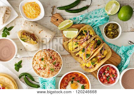 Variety of mexican cuisine dishes on a table