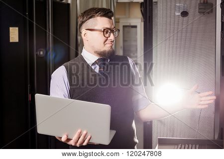 Young engineer in a datacenter