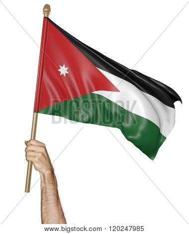 Hand proudly waving the national flag of Jordan