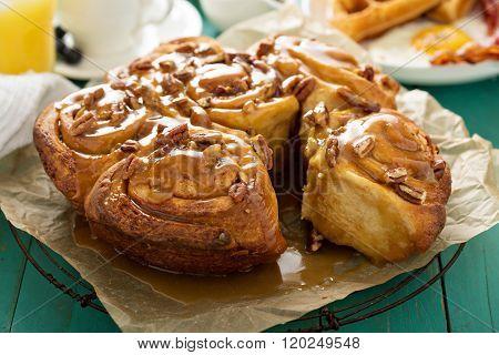 Sticky pecan buns on breakfast table