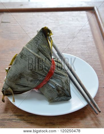 sticky rice steamed with pork and salt egg in banana leaf of Chinese Duanwu festival