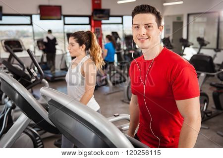 Athletic Guy Listening To Music And Doing Cardio