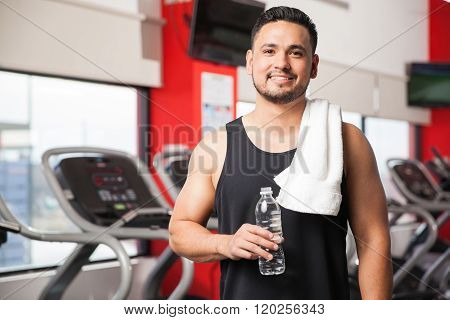 Young Man Taking A Break At The Gym