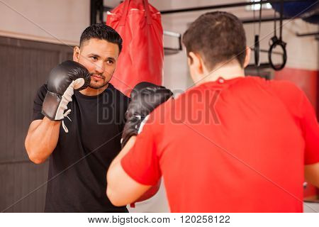 Male Friends Practicing Boxing At A Gym