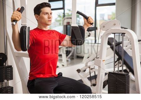 Young Man Working Out At The Gym