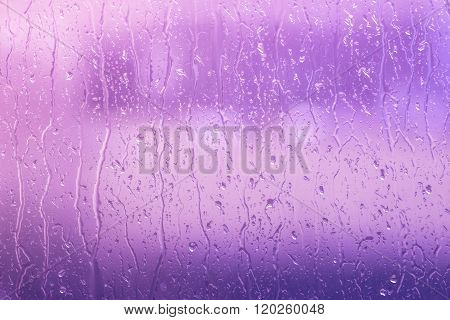 Rain On A Window In Purple Colors