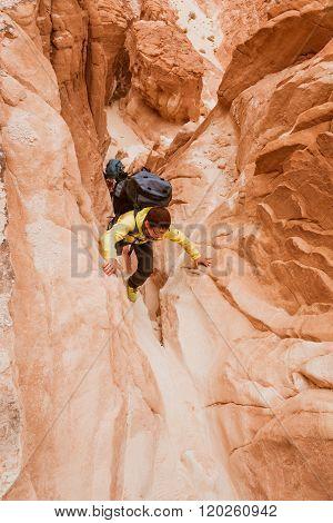 Woman Climbing In Canyon, Sinai, Egypt