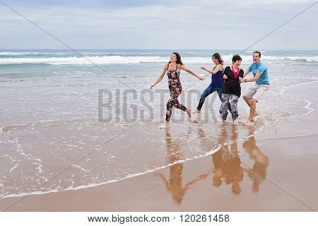 Family having fun with each other in the beach water