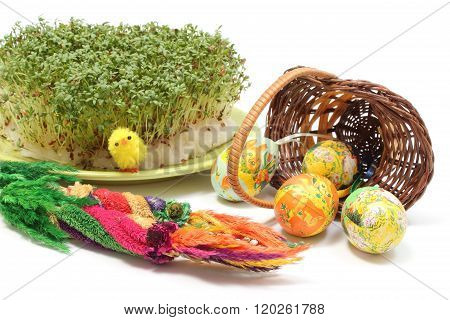 Easter Palm And Eggs In Overturned Wicker Basket And Watercress