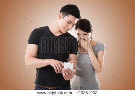 Asian young couple using cellphone, closeup portrait.
