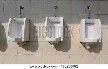 White Ceramic Of Urinals In Men's Bathroom.