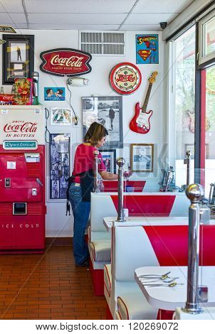 Gallup, U.S.A. - May 23, 2011: New Mexico, a young maid in a vintage style restaurant on the Route 66.