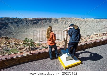 Meteor City, U.S.A. - May 24, 2011: Arizona, a young couple of tourists in the meteor crater near the Route 66.