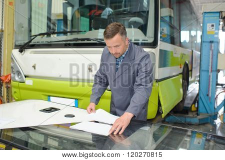 Man in bus depot