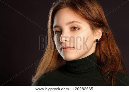 Portrait Of Redhead Woman On Dark