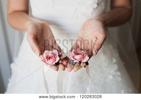 Bride Holding The Bridesmaid's Flowers