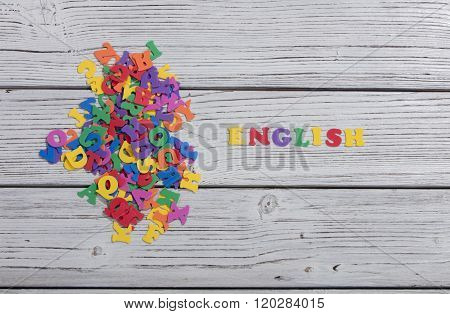 many colorful words on white wooden background, english