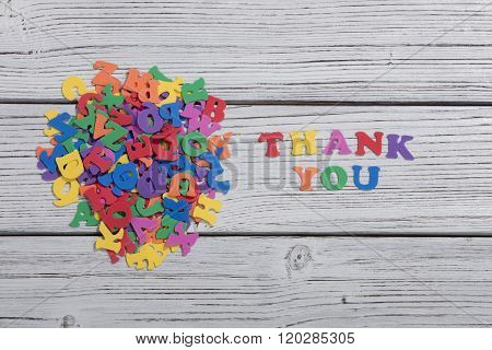 many colorful words on white wooden background, thank you