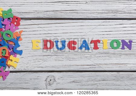 many colorful words on white wooden background, education