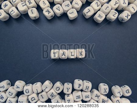 Word Talk Of Small White Cubes On A Dark Background