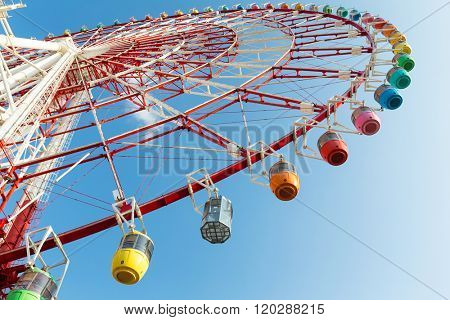 Big Ferris wheel with blue sky