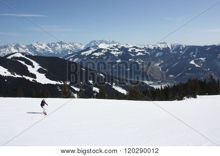 Young Woman Snowboarder. Zell Am See Skiing Resort.