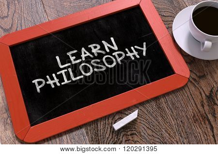 Learn Philosophy Handwritten on Chalkboard.