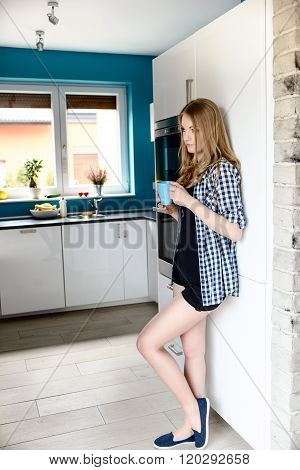 Beautiful Blonde Woman Drinking Coffee Or Other Drink