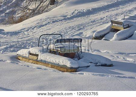 catamarans under snow in winter.