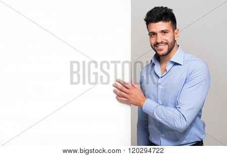 Portrait of a smiling man holding a white board