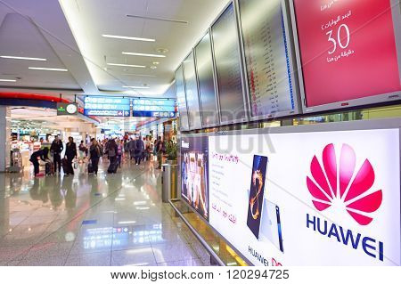 DUBAI, UAE - JUNE 23, 2015: airport interior. Dubai International Airport is a major international airport located in Dubai, and is the world's busiest airport by international passenger traffic.