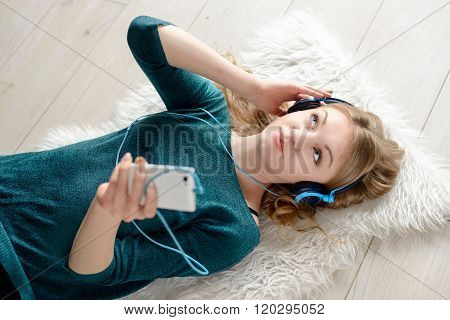Beautiful Young Blond Woman Listening To Music