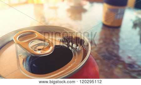 bee drinking from a soft drink