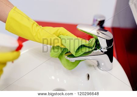 Female Hands With Rubber Protective Gloves Cleaning Tap