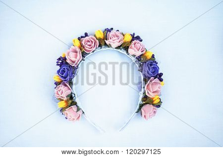 Hoop from flowers, wreath with colored flowers. Handmade flowers wreath on white. Accessory. Artific