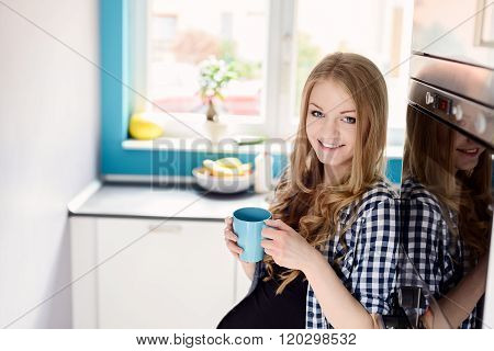 Blond Woman Drinking Tea Or Coffee