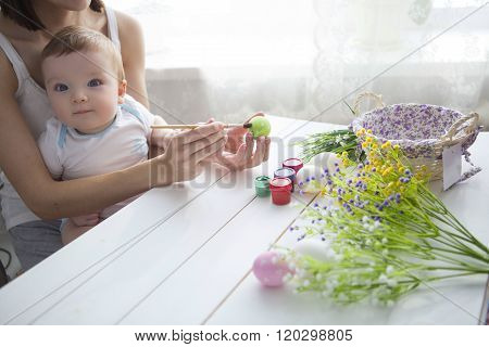 Little Toddler Boy And His Mother Decorating Easter Egg