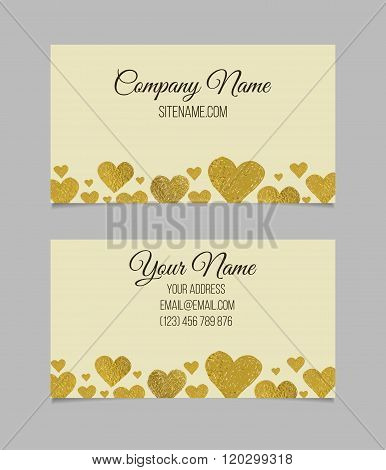 Visiting card with golden foil heart shape design.