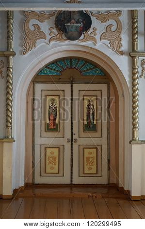 NIZHNE ABLYAZOVO RUSSIA - JANUARY 02 2016: The door to presbytery with the icons of the four evengelists and the Annunciation scene in Church of the Nativity of Christ in NIZHNE ABLYAZOVO Penza region Russia. popular landmark.