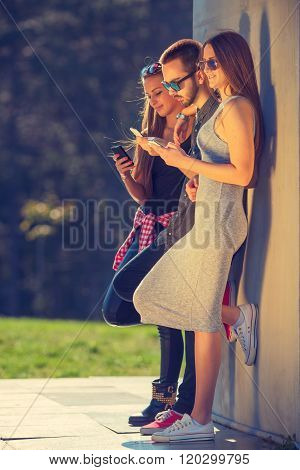 Group Of Friends Having Fun And Using Your Phones