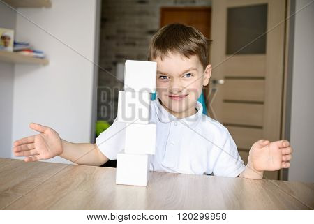 Frustrated Boy Destroying Brick Tower He Built.