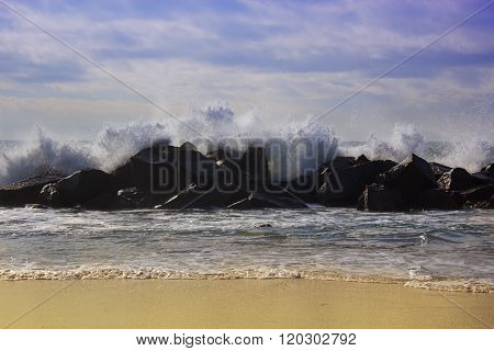 Big Waves Breaking Against The Rocks. Waves Breaking Over The Rocks